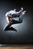 Young woman dancer jumping Stock Photos