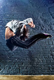 Young woman dancer jumping Stock Images
