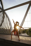 Young woman dancer making a classic ballet pose Royalty Free Stock Photography