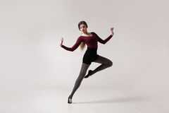 Young woman dancer in maroon swimsuit posing Royalty Free Stock Photography
