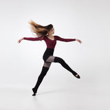Young woman dancer in maroon swimsuit posing Royalty Free Stock Photos