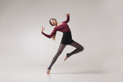 Young woman dancer in maroon swimsuit posing Royalty Free Stock Photo