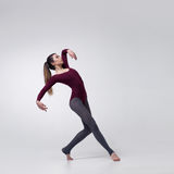 Young woman dancer in maroon swimsuit posing Royalty Free Stock Images