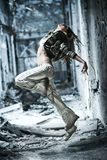 Young woman dancing. On industrial background stock photos