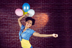 Young woman dancing with balloons Stock Images