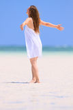 Young woman dancing at beach Stock Image