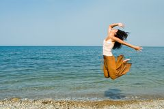 Young woman is dancing in the beach royalty free stock images