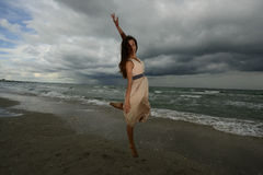 Young woman dancing on a beach Stock Photos