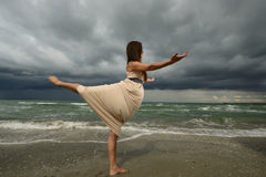 Young woman dancing on a beach Stock Images