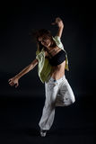 Young woman dancing on black background Stock Images