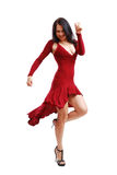 Young woman dancing in cocktail dress Stock Photo