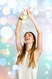 Young woman dancing with festive lights. Royalty Free Stock Photos