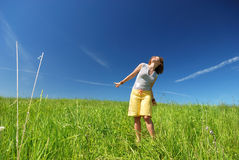 Young woman dancing on the field Royalty Free Stock Image