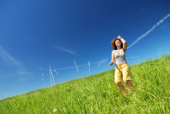 Young woman dancing on the field Royalty Free Stock Images