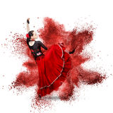 Young woman dancing flamenco against explosion. Young woman dancing flamenco with castanets against explosion isolated on white Stock Image