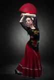 Young woman dancing flamenco on black Royalty Free Stock Photography