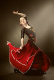 Young woman dancing flamenco on black Royalty Free Stock Images
