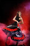 Young woman dancing flamenco on red fog Royalty Free Stock Photos