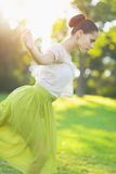 Young woman dancing in forest Stock Photos