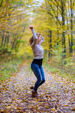 Young woman dancing in the forest Royalty Free Stock Image