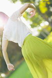 Young woman dancing on forest. Rear view Stock Images
