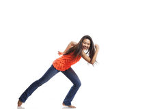Young Woman Dancing. Full body portrait of asian american dancer posing in studio on white background wearing casual jeans and colorful tank top Stock Photography