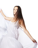 Young woman dancing in gorgeous white dress Stock Photography