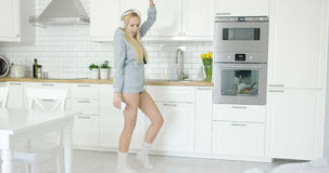 Young woman dancing in headphones Stock Images