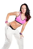 Young woman dancing isolated on white background. Happy cheerful female enjoying fitness dance stock photography