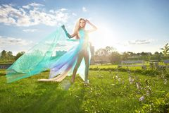 Young woman dancing in the morning bright spring Stock Photos