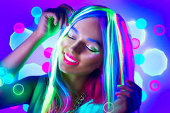 Young woman dancing in neon light royalty free stock photography
