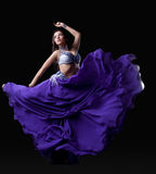 Young woman dancing oriental dance Royalty Free Stock Image