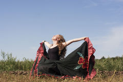 Young Woman Dancing Outdoors In Long Skirt Royalty Free Stock Photos