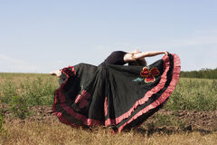 Young woman dancing outdoors in long skirt Stock Photos