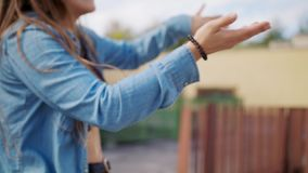 Young Woman Dancing Outside. A young woman dancing outside. Long shot. Soft focus stock footage