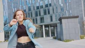 Young Woman Dancing Outside. A young woman dancing outside. Medium shot stock footage