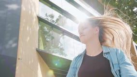Young Woman Dancing Outside. A young woman dancing outside. Medium shot. Lens flare stock video