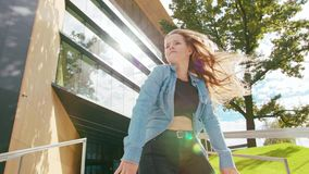 Young Woman Dancing Outside. A young woman dancing outside. Medium shot. Lens flare stock footage