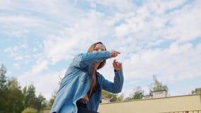 Young Woman Dancing Outside. A young woman dancing outside. Medium shot stock video