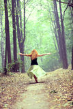 Young woman dancing in park. Portrait of young redhead woman dancing in park Stock Photos