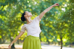 Young woman dancing in park Stock Photography