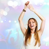 Young woman dancing with party background. Stock Photography