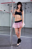 Young woman dancing with pole Stock Images