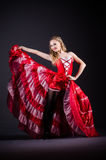 The young woman dancing in red dress Royalty Free Stock Images