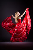 The young woman dancing in red dress Royalty Free Stock Photography