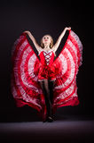 The young woman dancing in red dress Stock Photo