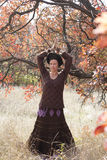 Young woman dancing ritual magic dance. In the autumn forest Royalty Free Stock Photo
