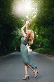Young Woman Dancing on the Road stock image