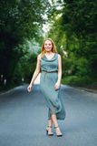 Young Woman Dancing on the Road royalty free stock image