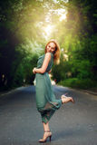 Young Woman Dancing on the Road stock photography